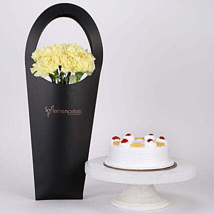 10 Yellow Carnations & Pineapple Cake Combo: Send Flowers In Sleeve