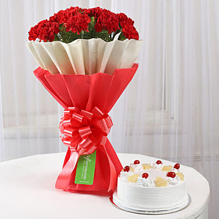 12 Red Carnations & Pineapple Cake Combo: Flowers N Cakes - anniversary