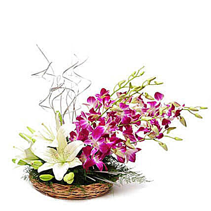Lilies And Orchids Basket Arrangement: Gifts to India