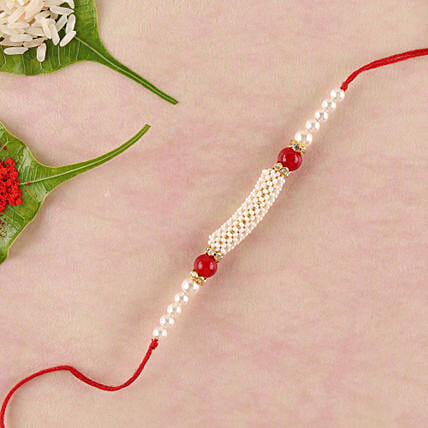 Gorgeous White And Red Beads Rakhi: Rakhi Delivery for Brother in Qatar