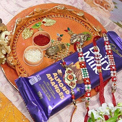 Red Beads Rakhi 4 With Dairy Milk Mixed Dry Fruits Thali