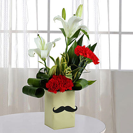 Best marriage anniversary gift for husband in india ferns n petals red carnation n leaves arrangement anniversary gifts for husband negle Images