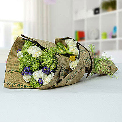 Delicate Flower Bouquet In Newspaper Packing