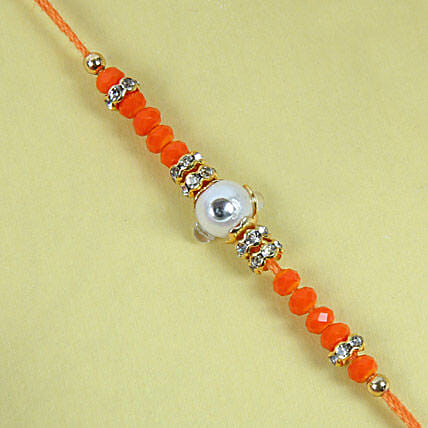 Fancy Orange Diamond Rakhi