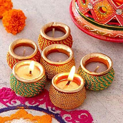 A Dozen Laced N Painted Clay Diyas